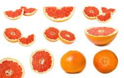 reeks van verschillende heerlijke en sappige die grapefruit, volledig van vitaminen en anti-oxyderend, op witte achtergrond wordt royalty-vrije stock foto
