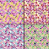Reeks van vier achtergronden met kleurrijke harten Stock Afbeelding