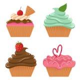 Reeks van vier cupcakes Royalty-vrije Stock Afbeeldingen