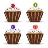 Reeks van vier cupcakes met fruit Stock Fotografie