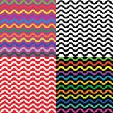 Reeks van vier naadloze patronen met golvende lijnen Stock Afbeelding