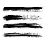 Reeks van vier zwarte grungeborstels Stock Afbeeldingen