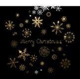 Reeks van vijfentwintig hand-drawn gouden textuursneeuwvlokken en inschrijvings Vrolijke Kerstmis Stock Fotografie