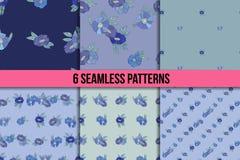 Reeks van zes naadloze patronen met blauwe bloemen Royalty-vrije Stock Foto