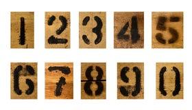 Reeks van zwart aantal op hout Stock Fotografie