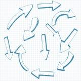 Reeks vectordiepijlen op geregeld document worden getrokken. Schetsstijl. Stock Afbeelding