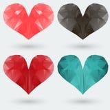 Reeks veelhoekige gekleurde harten op een grijze achtergrond Stock Foto's