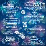 Reeks verkoopetiketten over blauwe Kerstmisachtergrond Royalty-vrije Stock Foto