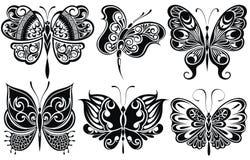 Reeks vlinderssilhouetten Stock Foto