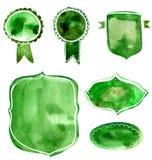 Reeks waterverf groene en blauwe kentekens en etiketten De vector artistieke elementen op wit verfomfaaien document achtergrond v Stock Fotografie