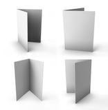 Reeks witte die bladen van document in de helft worden gevouwen Stock Foto