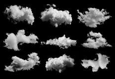 Reeks wolken op zwarte achtergrond stock afbeelding