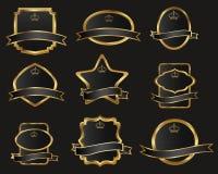 Reeks zwarte gouden-ontworpen etiketten Stock Afbeeldingen
