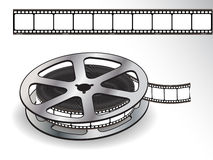 A reel of 35mm motion picture film on a white back Royalty Free Stock Photography