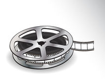 A reel of 35mm motion picture film on a white back. A reel of 35mm motion picture film Stock Photo