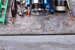 Reel and bobber on wood. Royalty Free Stock Photo