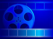 Reel with film into a blue background. Background for the cinema industry. Reel with film into a blue background Royalty Free Stock Photo