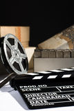 Reel with film and cinema clap Royalty Free Stock Photos