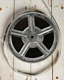 Reel of film in retro. Movie reel on a  white wooden background Stock Images