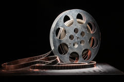 Reel of film in retro. Movie reel on a wooden background Stock Photos