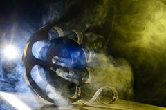 Reel of film retro in the smoke blue and yellow Royalty Free Stock Photos