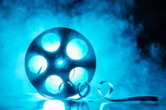 Reel of film with smoke and backlight Royalty Free Stock Photos