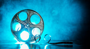 Reel of film with smoke and backlight. Old reel of film with smoke and backlight royalty free stock image
