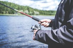 Reel fishing Stock Images