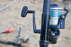 Reel in a fishing rod Royalty Free Stock Photo