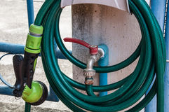 Reel of hose pipe and spraying head. With tab water outlet for gardening royalty free stock image
