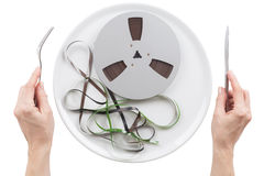 Reel magnetic tape on a plate Stock Photos