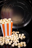 Reel or Movie role and popcorn for Cinema and Movie theater Royalty Free Stock Image