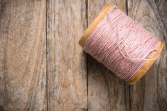 Reel pink yarn right side on wood royalty free stock image