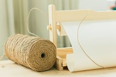 Reel with string for gift wrapping on wooden table royalty free stock images