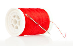 Reel with thread and needle on a white background Royalty Free Stock Photography