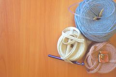 Reel thread. Three reel thread with knitting hook. Copy space royalty free stock image