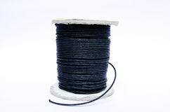 Reel of twine. Reel of black twine on a white background Stock Photo