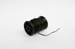 Reel of twine. Reel of black twine on a white background Royalty Free Stock Image