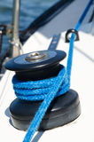 Reel on the yaht deck. Blue rope on the reel Stock Photos
