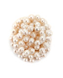 Reeled up pearl necklace. On white background top view Royalty Free Stock Photography