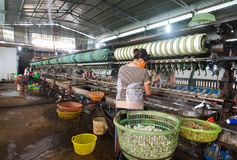 Reeling or unwinding the silk filaments from silkworm cocoons Stock Photography