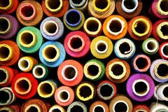 Reels of color threads on black Stock Photo
