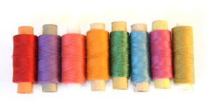 Reels of color threads on white Royalty Free Stock Image
