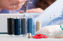Reels of colour threads and sewing accessories Royalty Free Stock Images