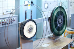 Reels with long videotape in small room. Of old movie theater Stock Photography