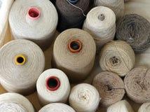 Reels of Natural Fibres, Milan. Reels of non dyed natural fibres at Milan, Italy, street market, stall royalty free stock photos