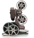 Reels and projector. Film reels and vintage movie projector on white stock photography