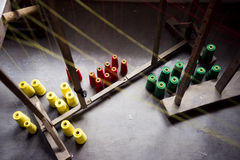 Reels. Red, yellow and green coloured reels in a Hablon workshop royalty free stock images