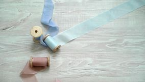 Reels of ribbon. Rolling on the floor stock video