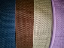 Reels with ribbons of different colors for needlework. stock image